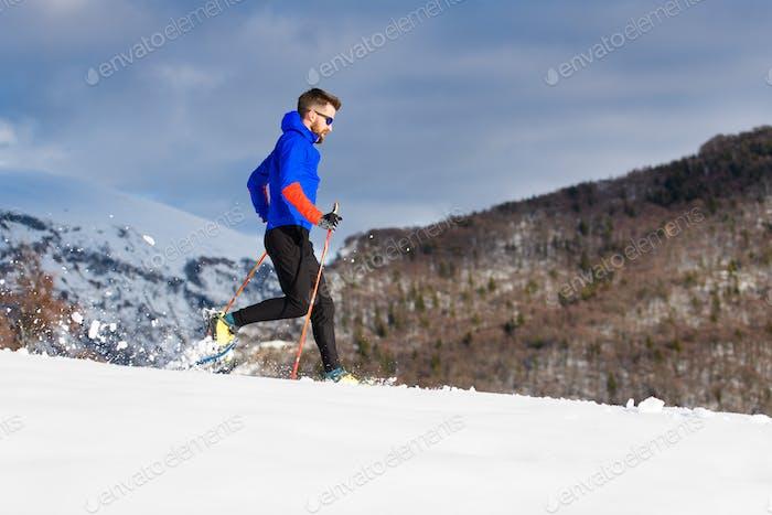 Snowshoeing downhill