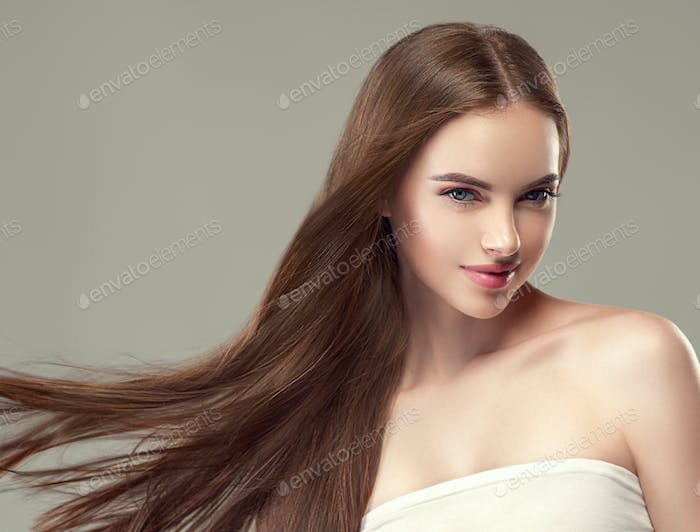 Beautiful hair smooth long brunette beauty woman healthy hairstyle young
