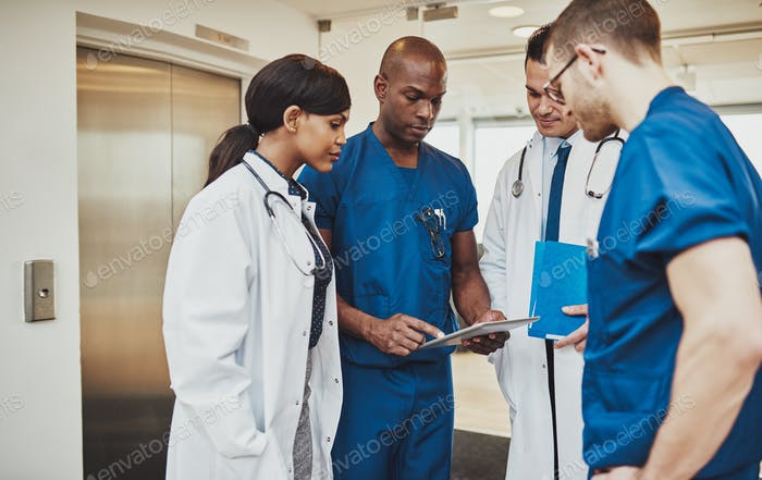 Black surgeon giving instruction to medical team
