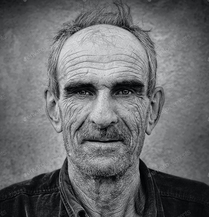 Artistic old photo of elderly bald man, grunge vintage backgroun