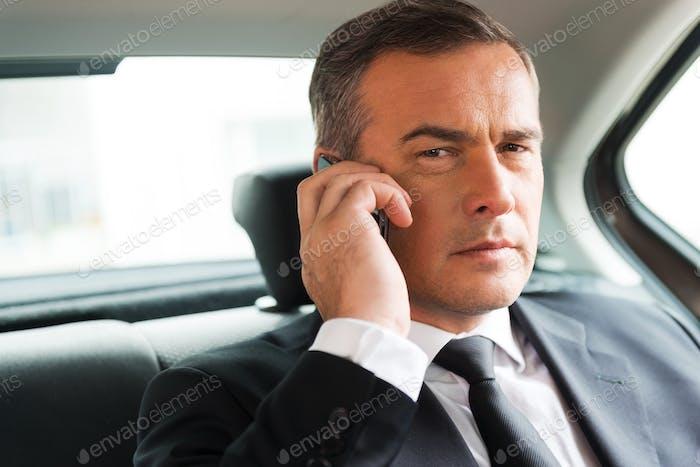 Successful businessman in car.
