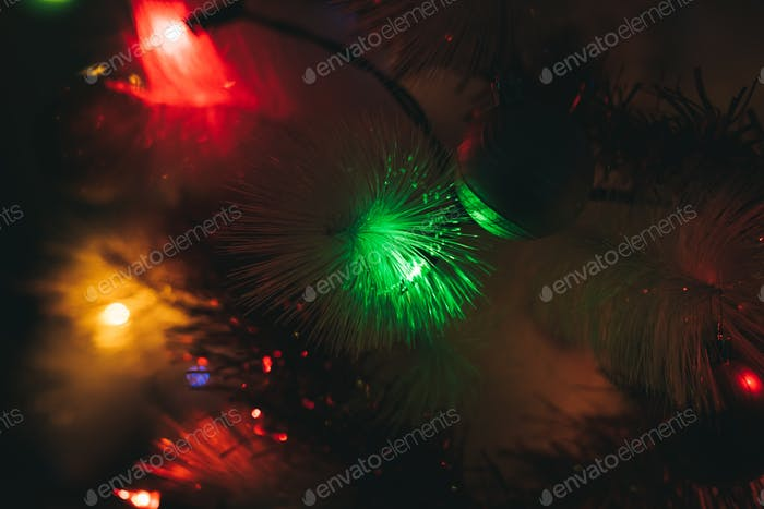 Close up on the christmas tree green light decoration - - christ