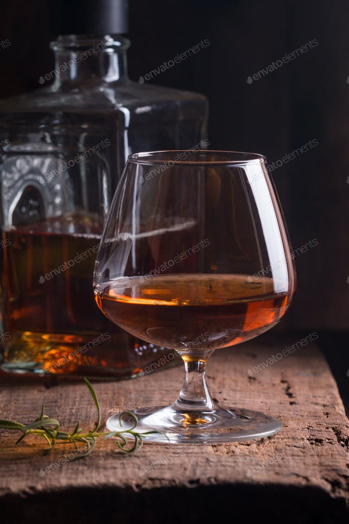 Glass of brandy or cognac and bottle