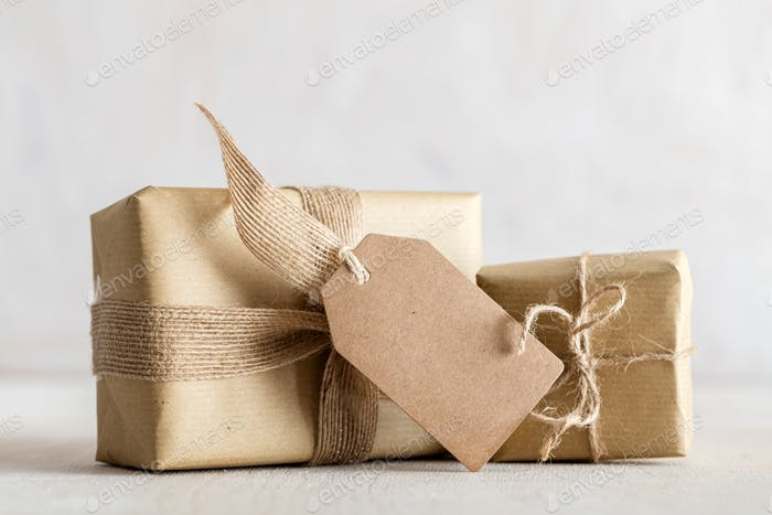 Rustic retro gifts, present boxes with tag. Christmas time, eco paper wrap.