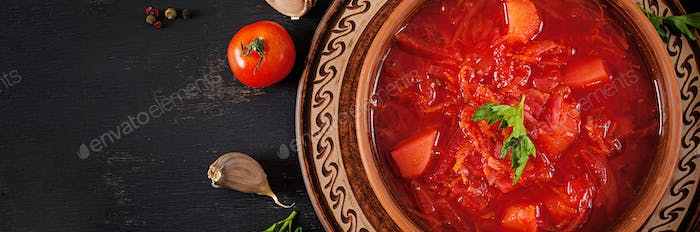 Traditional Ukrainian Russian borscht or red soup on the  bowl. Banner. Top view