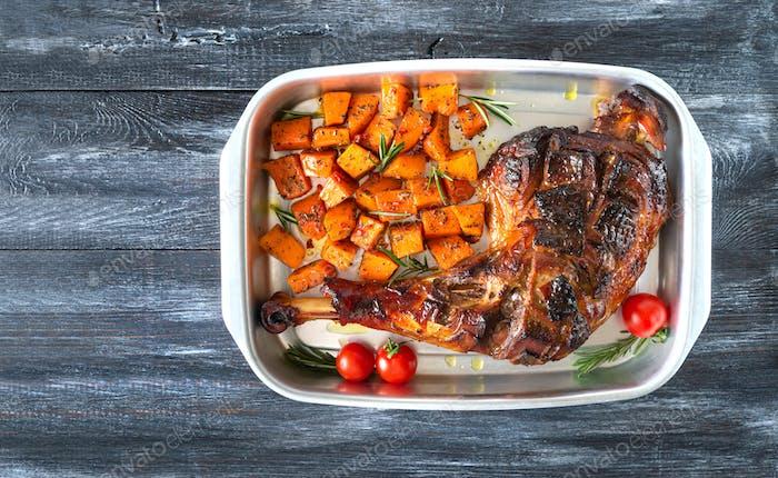 Baked turkey leg with spiced pumpkin slices. Celebratory dish, Thanksgiving. Diet menu. Top view.