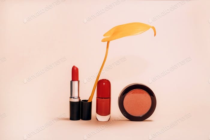 Decorative composition with cosmetics and Autumn leaves