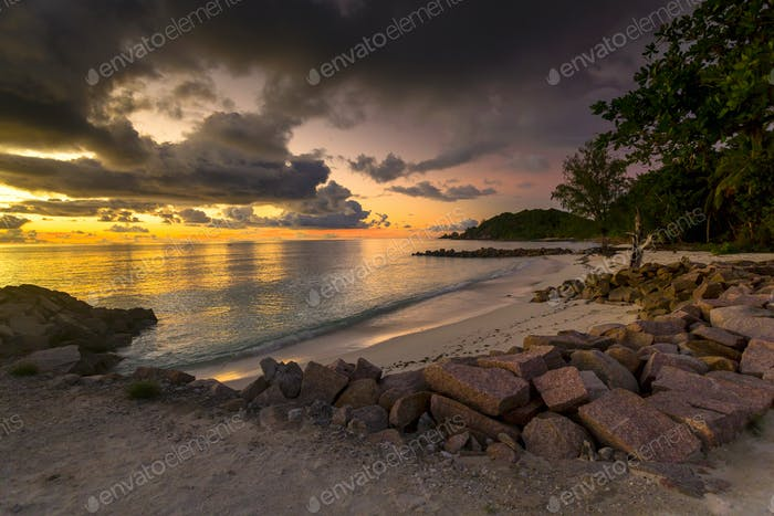 Anse Kerlan beach at the sunset