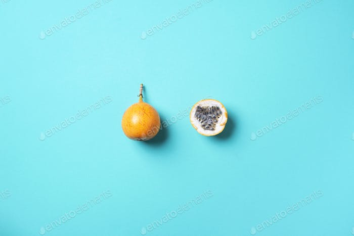 Sweet granadilla or grenadia on blue background. Top view. Copy space. Creative design banner