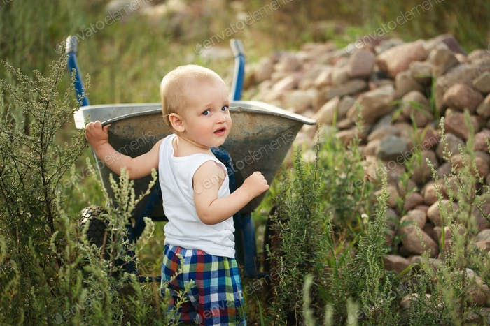 little boy with wheelbarrow