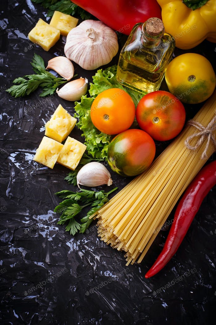 Concept of Italian food. Pasta, tomato, olive oil, pepper, parsley and cheese