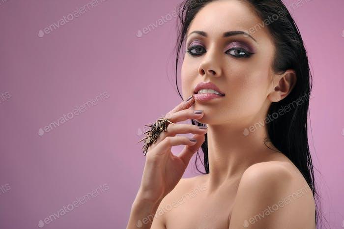 Young woman posing sensually at studio