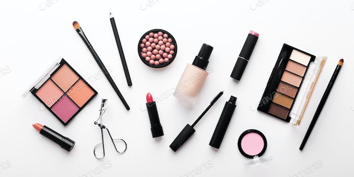 Assortment of luxury cosmetics for every day makeup on white