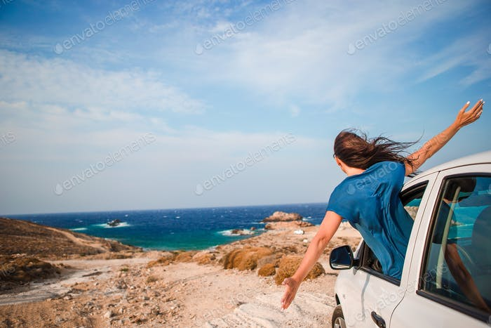 Young woman on vacation travel by car