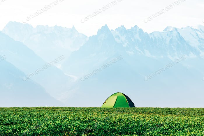 Green tent in spring mountains