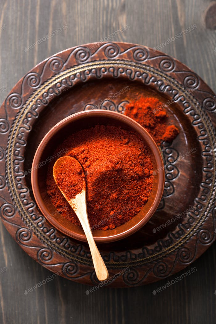 red paprika powder spice in bowl