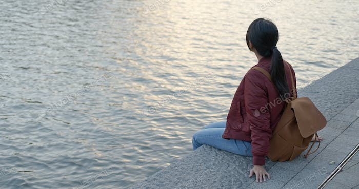 Woman sit at the river side