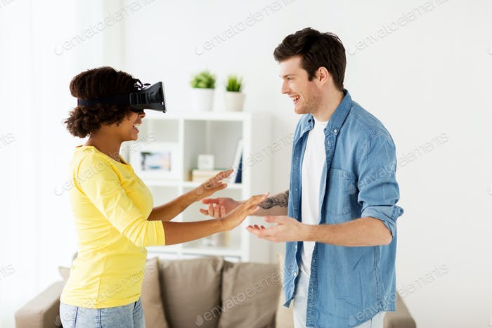 happy couple with virtual reality headset at home