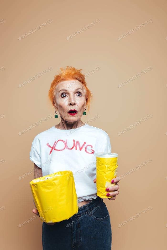 Shocked mature redhead fashion woman