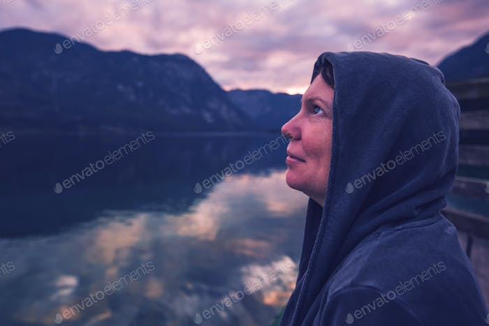 Lonely woman looking at dramatic sky