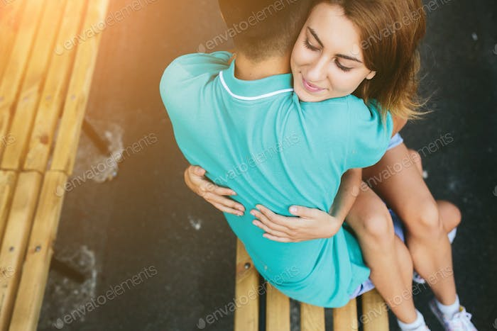 guy and the girl sitting on a bench