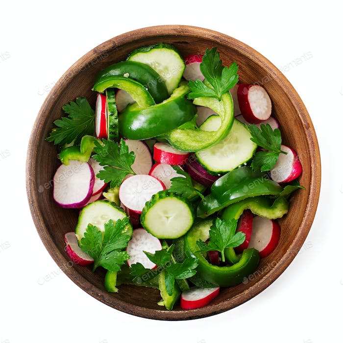 Fresh salad of cucumbers, radishes, green peppers and parsley. Flat lay. Top view