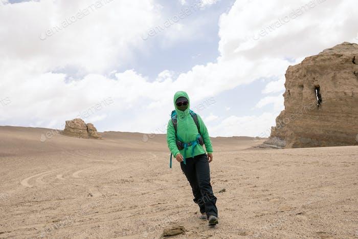 Backpacke solo hiking on desert
