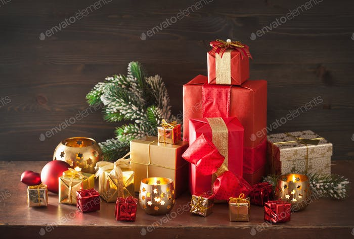 red and golden christmas gift box and decoration lantern candle