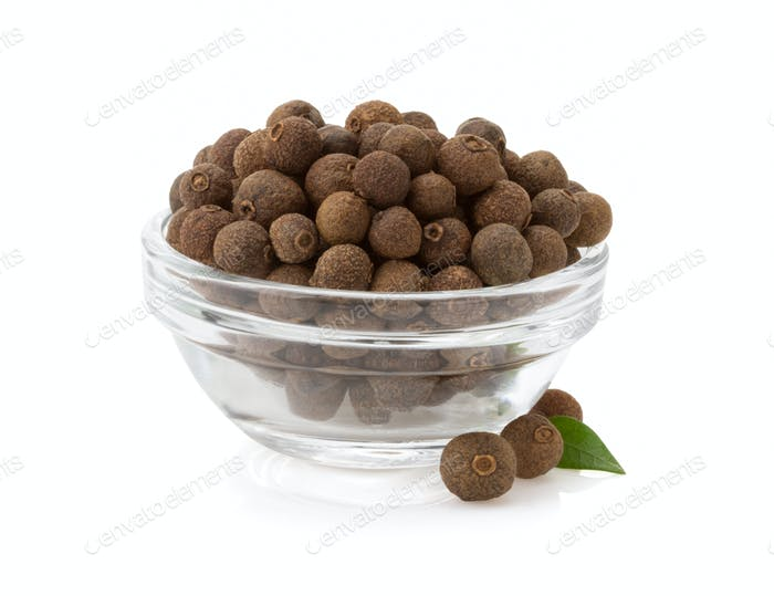 allspice in bowl on white