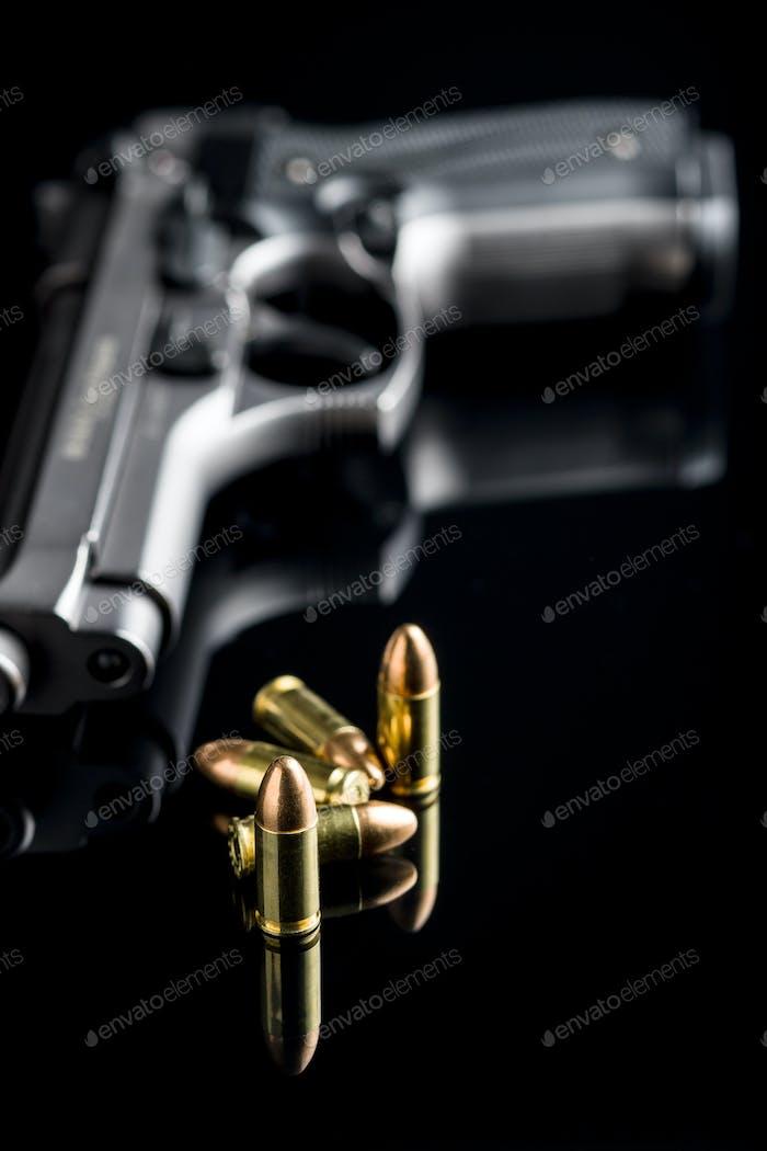 9mm pistol bullets and handgun.