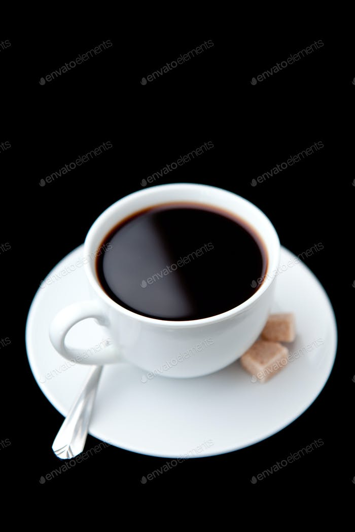 Cup of coffee  with brown sugars against a black background