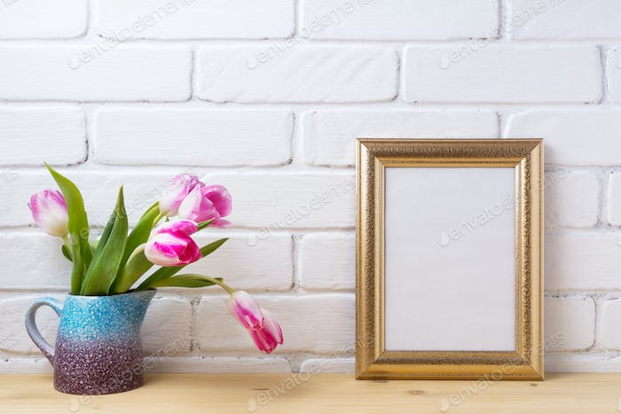 Gold decorated frame mockup with magenta pink tulips