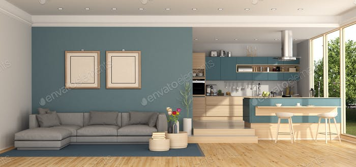 Blue living room with kitchen on background
