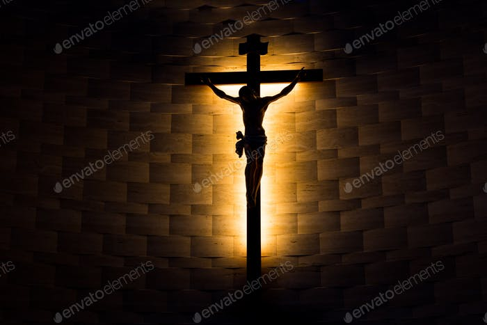 Crucifix of the Catholic Christian faith in silhouette