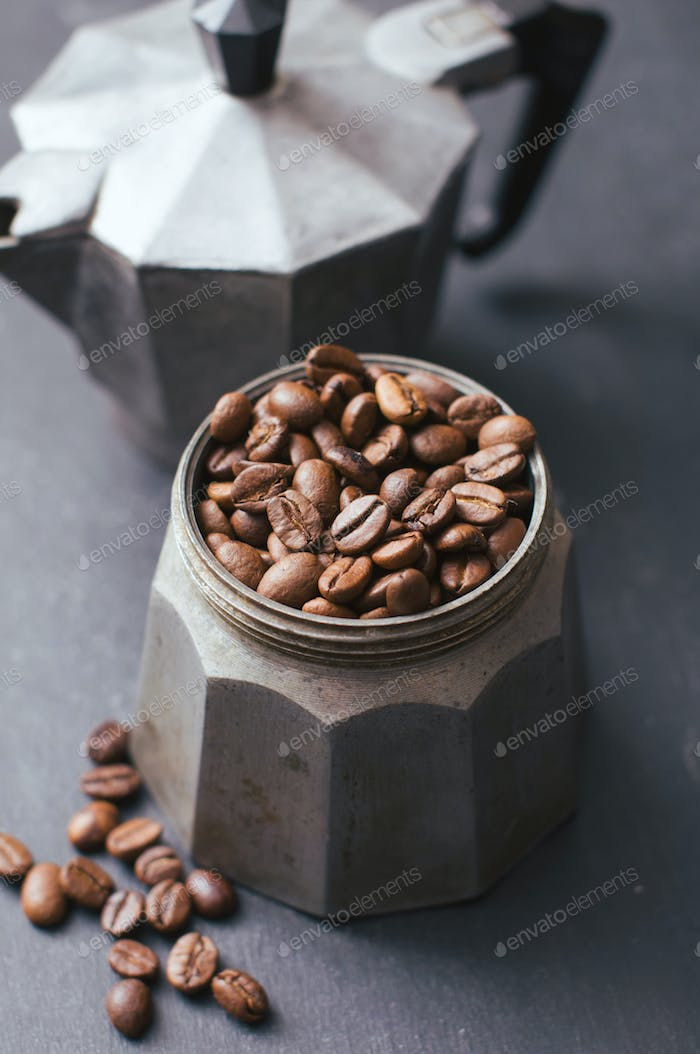 Coffee beans in vintage coffee jug