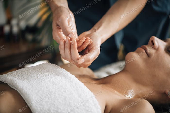 Ayurvedic Aromatherapy Oil Massage. Masseuse Holding Ayurveda Oil for Body Massage