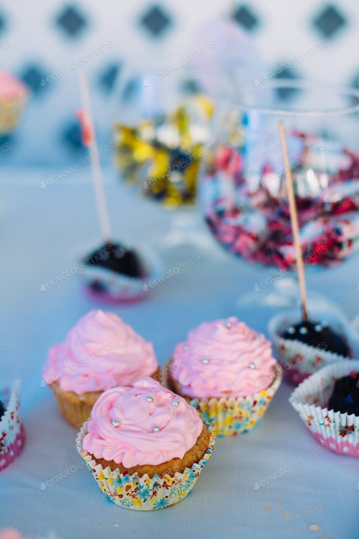 Dessert Sweet Cupcakes, Candy, confection On Table. Candy bar. D