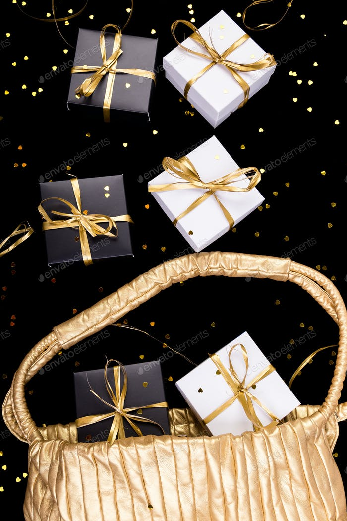 Black and white gift boxes with gold ribbon