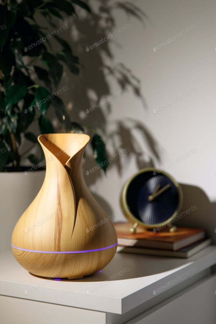 Aroma oil diffuser in the form of a jug on the bedside table