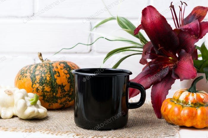 Black campfire enamel mug mockup with pumpkin and red lily