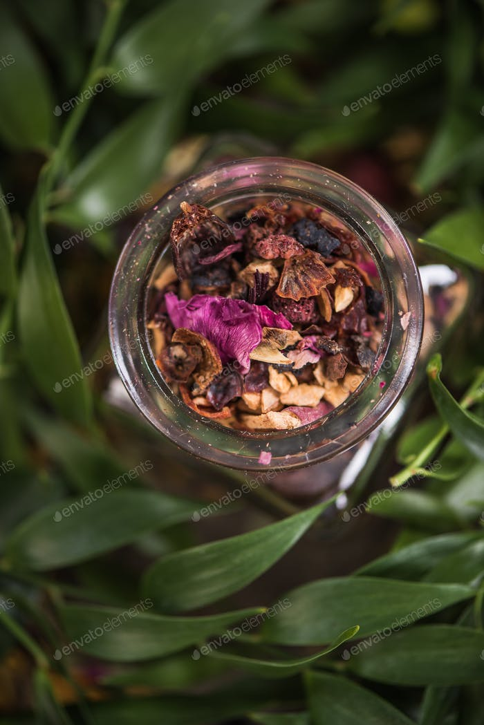Aromatic colorful tea in glass jar
