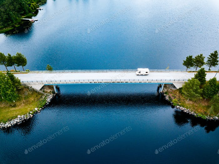 Aerial view Caravan trailer or Camper rv on the bridge over the lake in Finland.