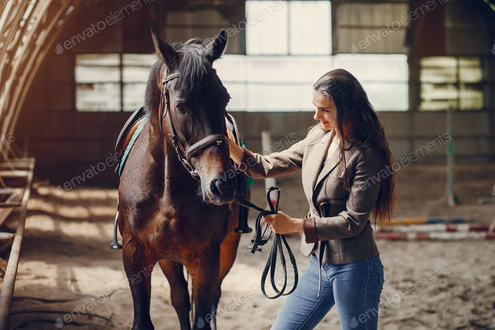 Beautiful woman spend time with a horse