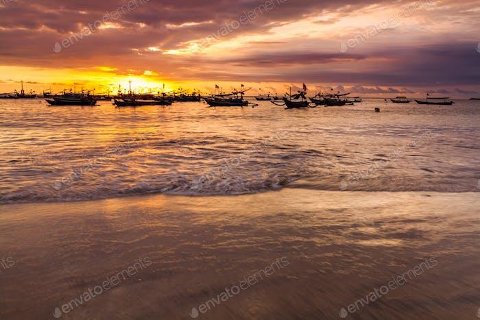 Sunset on the beach of Jimbaran. Bali
