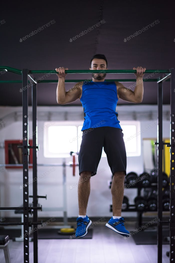 Thumbnail for man doing pull ups on the horizontal bar