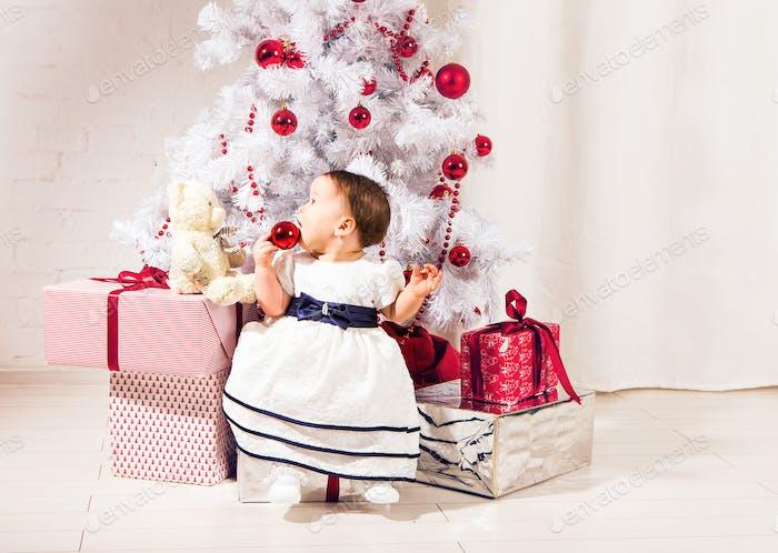 happy baby child girl near a Christmas tree