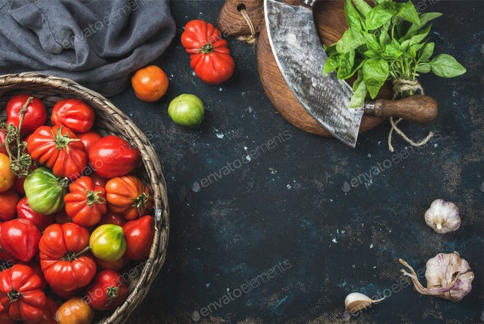 Fresh colorful ripe heirloom tomatoes in basket, copy space