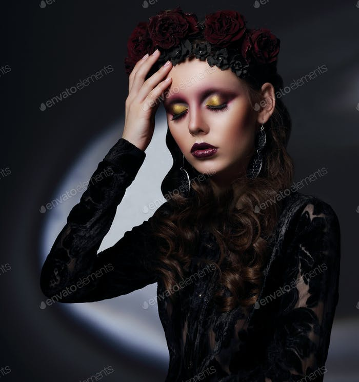 Woman with theatrical makeup in spotlight