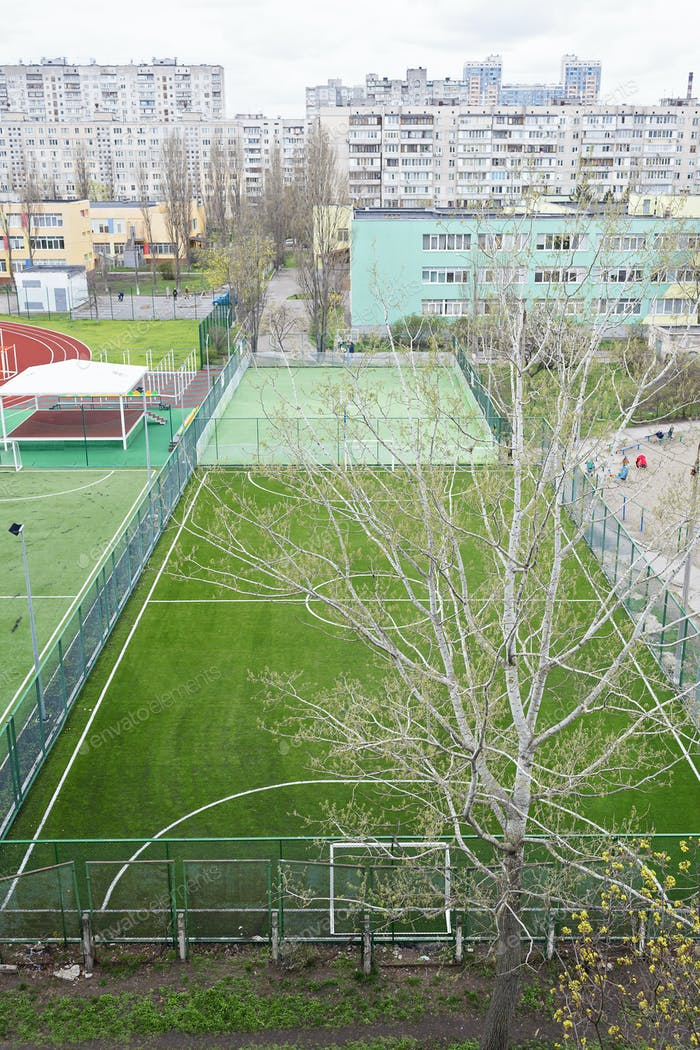 Open city sports grounds for playing football. Stadium, empty field during lockdown, top view