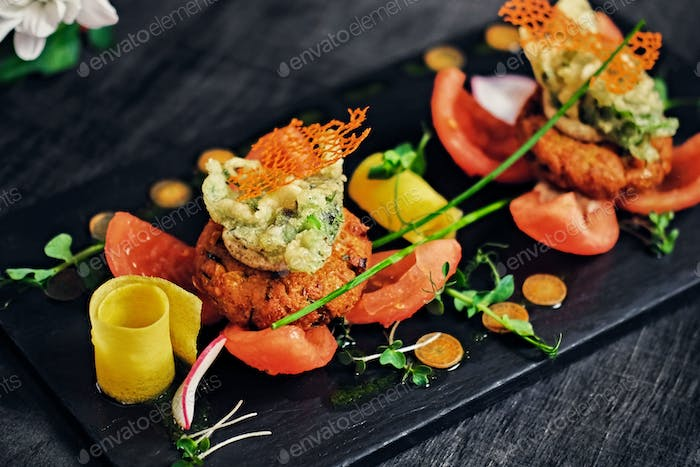 Seafood snacks with tomatoes.